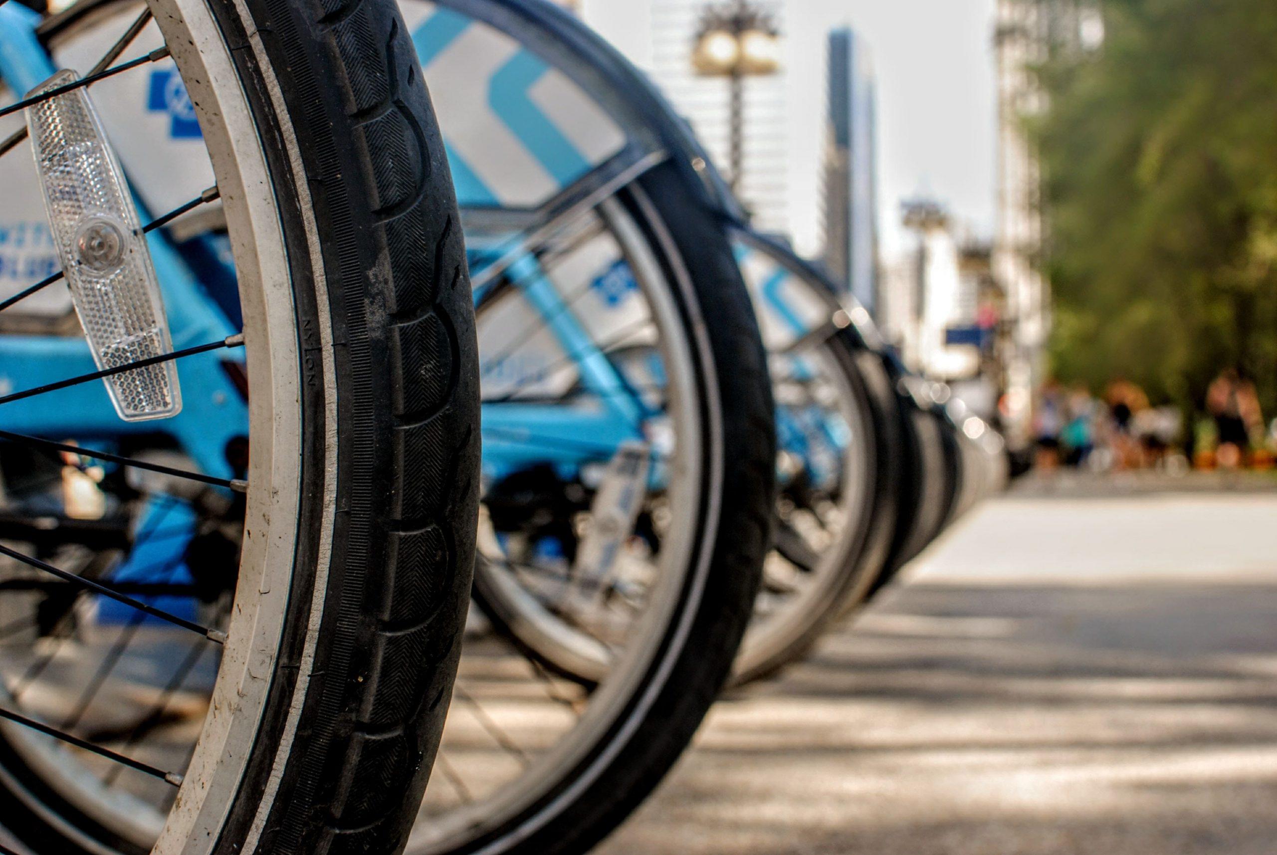row of rental bikes in city